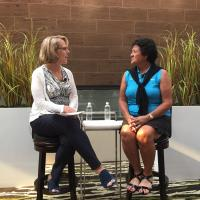 gail baker and nancy lopez speaking on stage